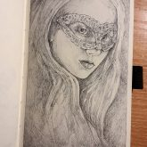 Girl with mask drawing portrait