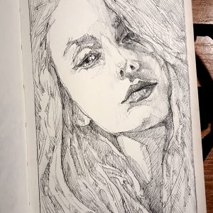 Woman drawing portrait – Sketchbook drawing